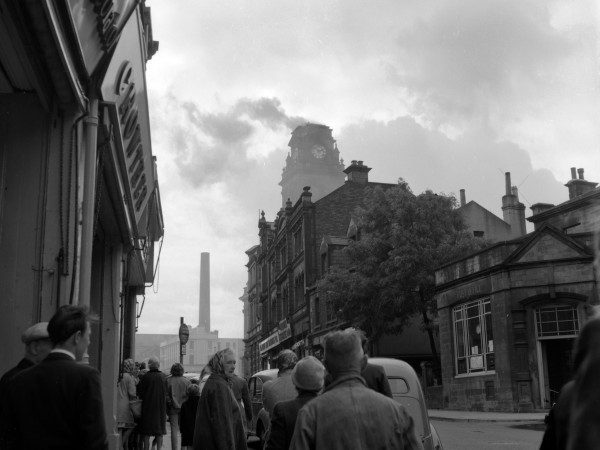 Courtesy of MCA: Town Hall Fire. This is a photo taken from Scatcherd Hill on Queen Street around mid-day on 18-August-1960 when the Town Hall dome had caught fire from sparks generated from a nearby mill fire. The dome was demolished and later rebuilt. The photo was taken by Mr Bobby Cooper, a local pharmacist at the time, who was a leading member of the Morley Photographic Society. Many of his fine photos were given to MCA by his widow Grace.