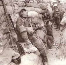 Photo Credit: Cheshirelieutenancy.org.uk. Image of soldiers in a trench during the First World War.